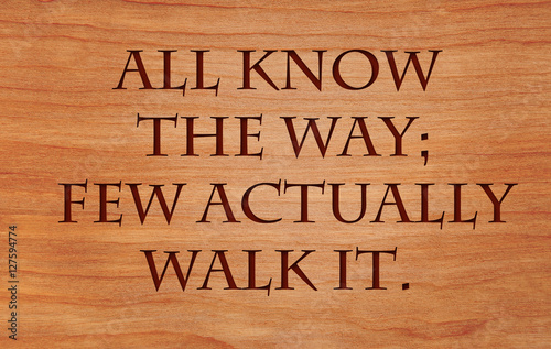 Photo  All know the way; few actually walk it -  a quote on wooden red oak background