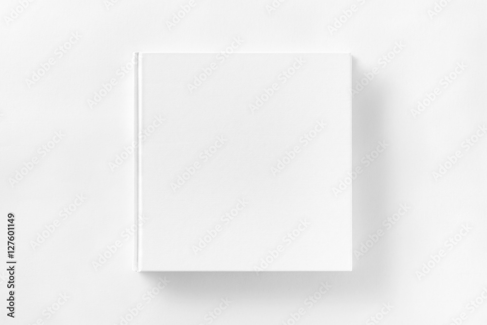 Fototapety, obrazy: Mockup of closed blank square book at white textured paper