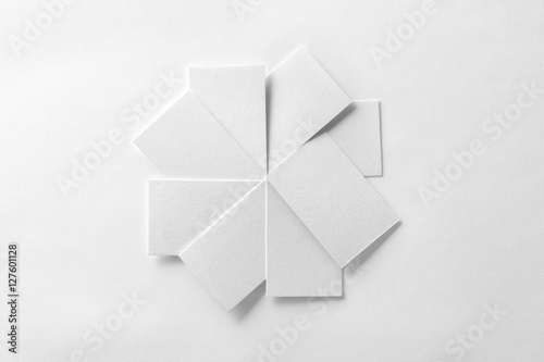 Valokuva  Mockup of blank business cards fan stack at white textured paper