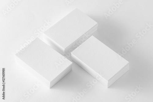 Fotografia, Obraz  Business cards stacks mockup at textured white paper background.