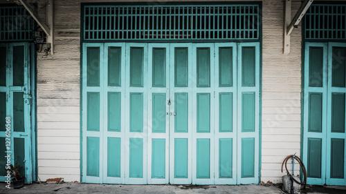Retro photo. side rode and classic door in Yaowarat road,Bangkok capital city, Thailand.Take photo : September 10, 2016
