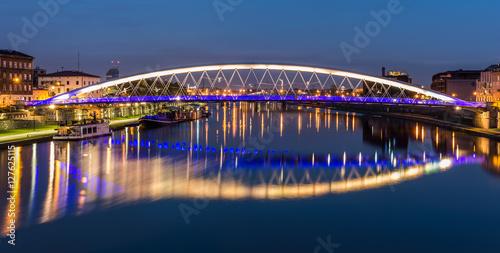 Fototapeta Bernatka footbridge over Vistula river in Krakow in the night obraz