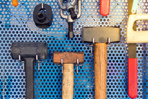 Fotografie, Obraz  Collection of hammer tools tidy on board in garage