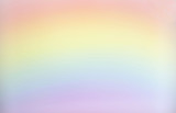 Fototapeta Rainbow - horizontal blank background image of pastel red and yellow and blue and pink rainbow great for copy or text space  and great for greeting cards.