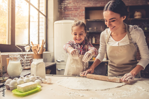 Mom and daughter baking Canvas Print