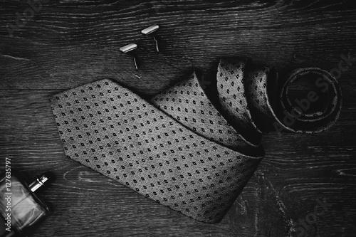 Fotografia Stylish mens business accessories tie cologne cuff links