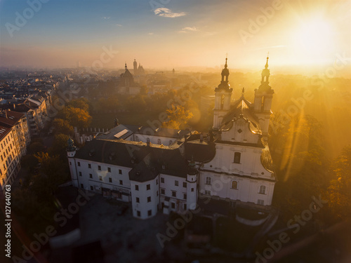 Fototapeta Aerial view of misty dawn over the church in Krakow. obraz
