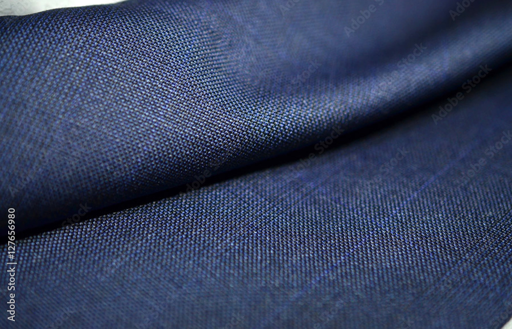 Photo & Art Print close up roll texture blue fabric of suit