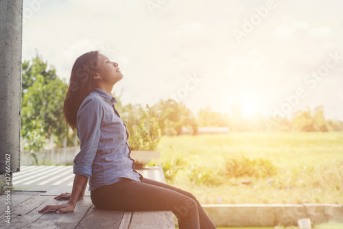 Young hipster woman lounging, relaxing atmosphere in the morning Fototapeta