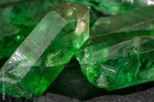 Closeup of a bunch of many green rough uncut emerald crystals Wallpaper Mural