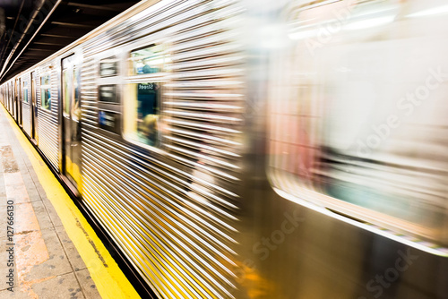 New York City subway train leaving its station - motion blur as the train passes