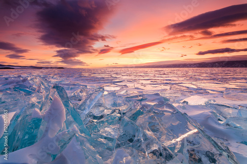 Photo Stands Coral Colorful sunset over the crystal ice of Baikal lake