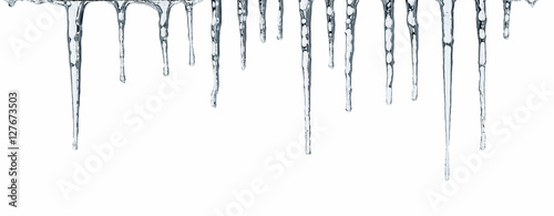 Fotomural Close up of icicles isolated on white background