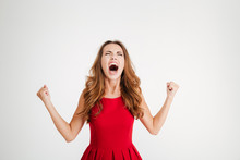 Mad Furious Young Woman With Raised Hands Standing And Screaming