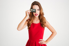 Beautiful Playful Young Woman Covered Her Eye By Credit Card