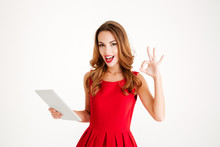Woman In Red Dress Holding Tablet Computer