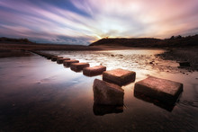 Three Cliffs Bay Stepping Stones Sunset At The Stepping Stones That Allow Access To The Divided Beaches At Three Cliffs Bay On The Gower Peninsula In Swansea, South Wales