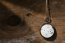 Broken Pocket Watch On Wooden ...