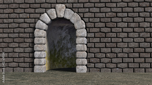 Vászonkép Brick wall with cyclopean boulder arch and bent corridor darkly lit and moldy