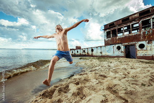 6b288c6e9 boy shorts is happy jumps and flips on the beach in summer - Buy ...