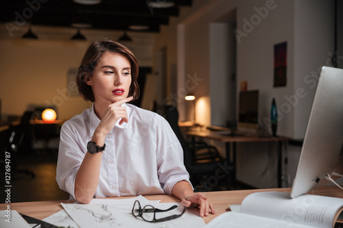 Fotografia, Obraz  Pensive woman fashion designer sitting and working in office