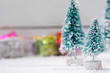 Christmas trees with snow and gift boxes - selective focus