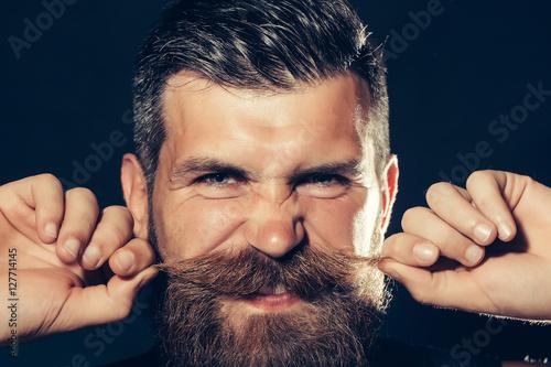 Funny bearded man twirls moustache Canvas Print