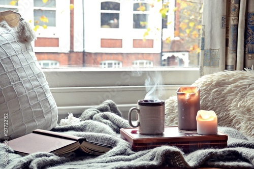 Fototapeta Cozy home. Candles, book and cup of tea obraz