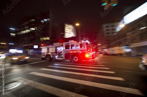 Obraz na plátne Fire truck on the street