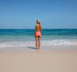 Young woman standing on serene beach