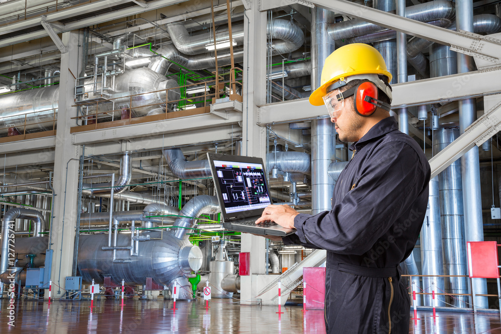 Fototapety, obrazy: Engineer using laptop computer for maintenance in factory