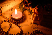 Christmas Decorations, Candles, Figures Of Angels And Notes