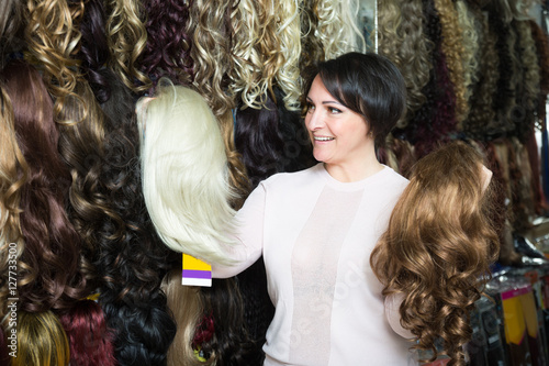 Middle Aged Female Customer Selecting Natural Hair Wig In Hair S