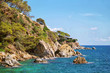 Beautiful natural rock near of Tossa de Mar, Costa Brava, Spain. Bay and crystal clear water of Mediterranean Sea. Amazing blue green sea and sunny day.
