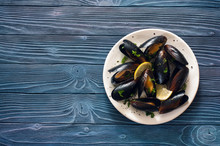 Mussels On White Plate Over Bl...