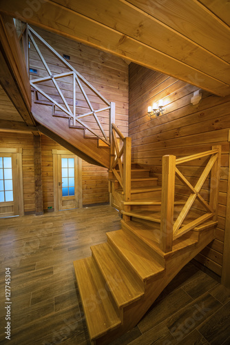 Tuinposter Trappen Wooden stair - Stair in a wood house