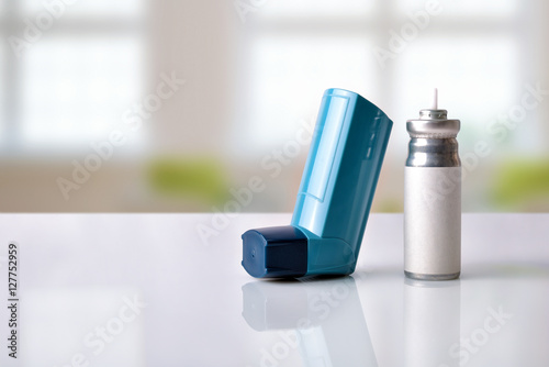 Photo Cartridge and blue medicine inhaler in a room front view