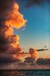 Beautiful sunrise with burning cloudscape over the sea