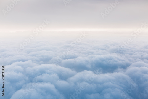 Fotografie, Obraz  Above the clouds. A view from an airplane.