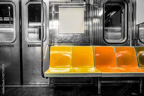 Canvas Print New York City subway car interior with colorful seats