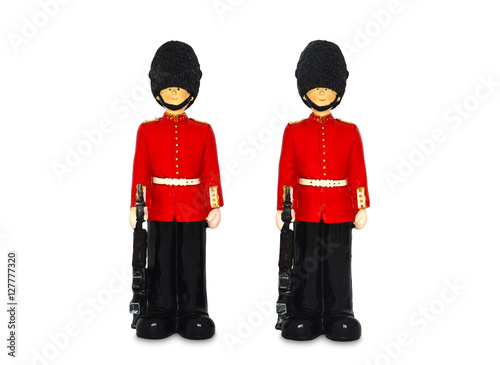 Photo two Queen's guard statue in traditional uniform with weapon, British soldier, is