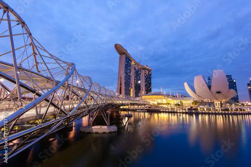Tuinposter Singapore MARINA BAY, SINGAPORE - Aug. 18, 2013 : Helix Bridge with the Marina bay sands, Singapore travel landmark