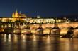 Prague Castle and Charles Bridge at night.