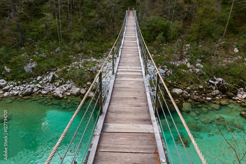 Garden Poster Forest river Wooden bridge the turquoise green Soca river in Slovenia