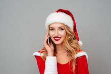 Woman In Santa Costume With Hat Talking On Cell Phone