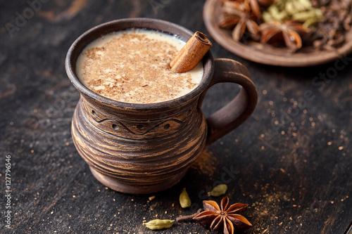 Fotografie, Obraz  Masala pulled tea chai latte homemade hot Indian sweet milk spiced drink, ginger