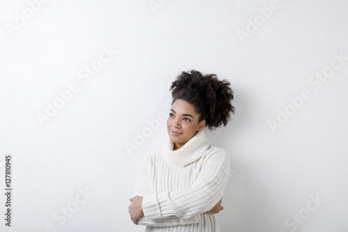 Portrait of a young woman in white turtleneck, copy space Fototapet