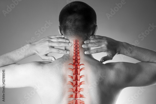 Juliste  Spine pain, man with backache and ache in the neck, black and white photo with r