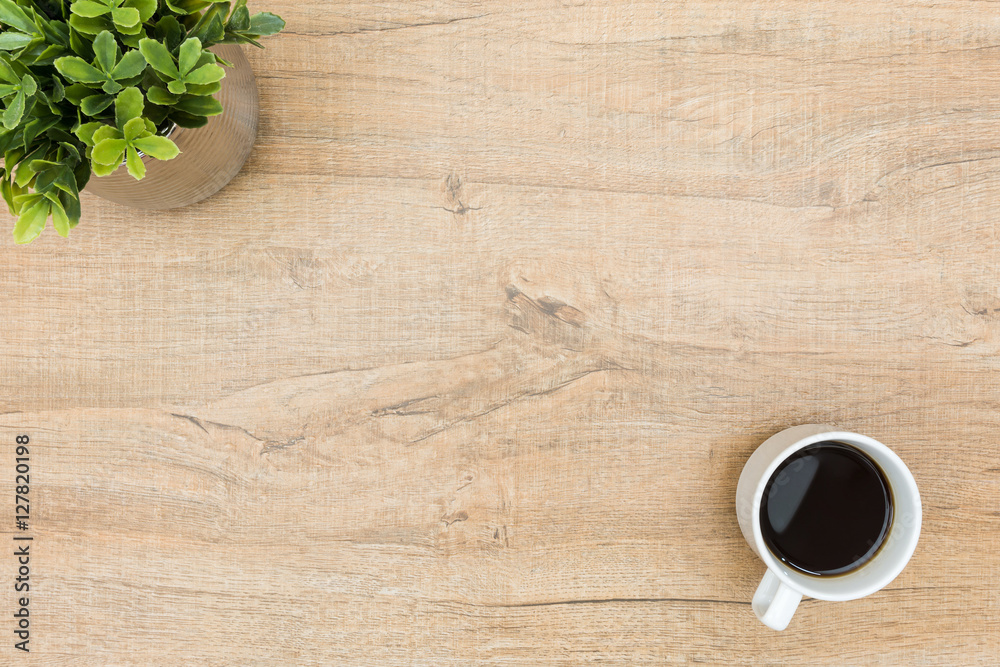 Fototapety, obrazy: Minimal wood table with coffee and a small plant. Top view with copy space, flat lay.