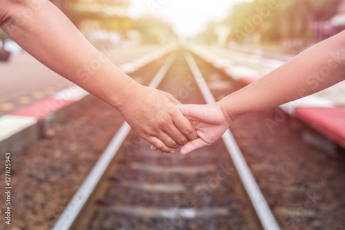 Poster Voies ferrées Woman holding her daughter hand at the railway